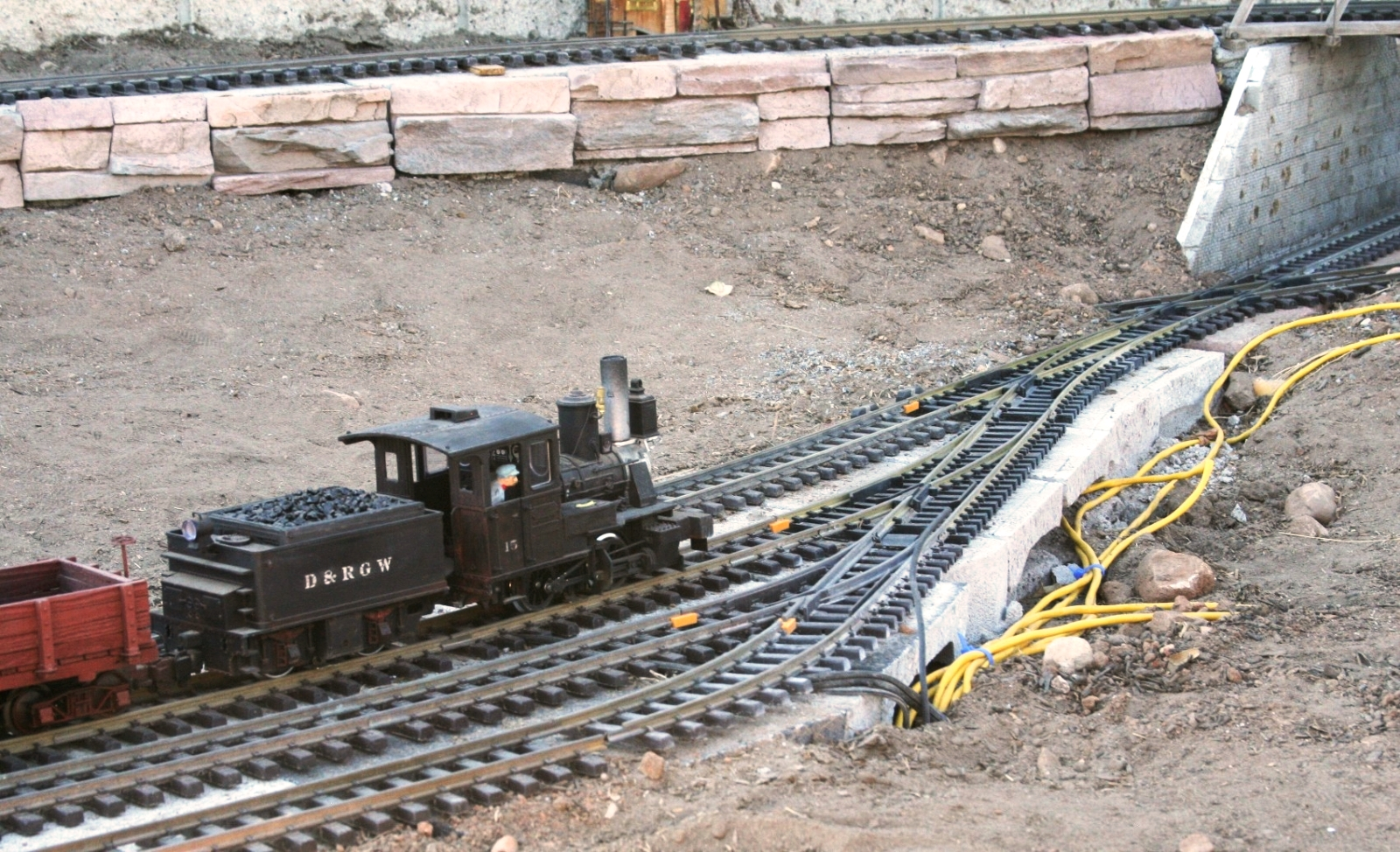 dotson.A steam engine runs smooth on track supported by concrete blocks