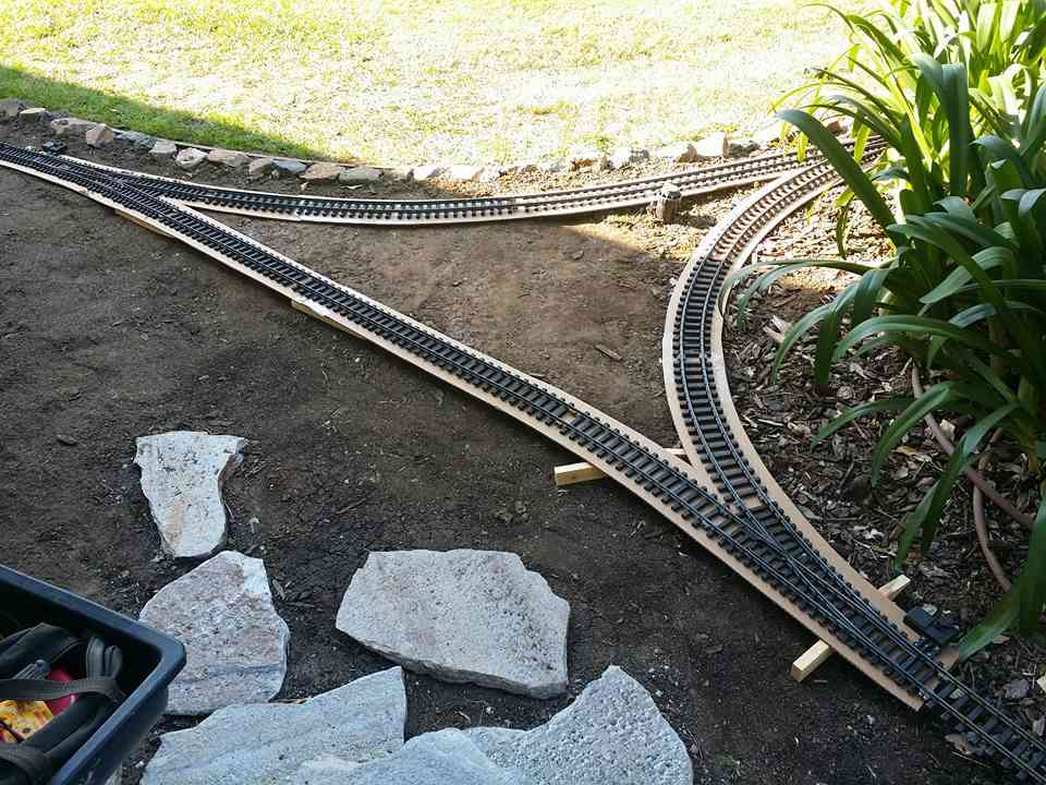 C  Track on completed cardboard forms for roadbed placement