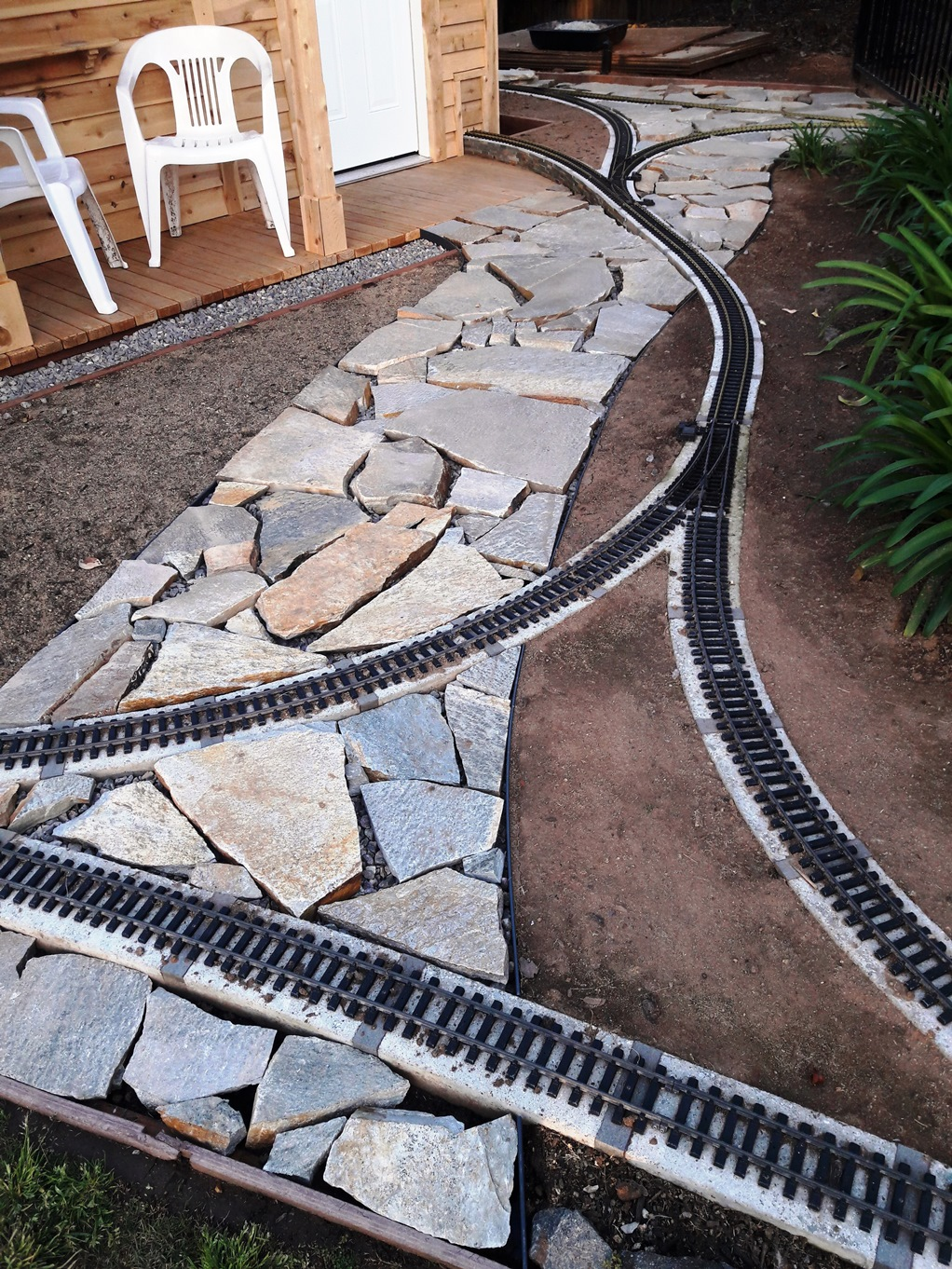 T  Track and Flagstone walk goes in